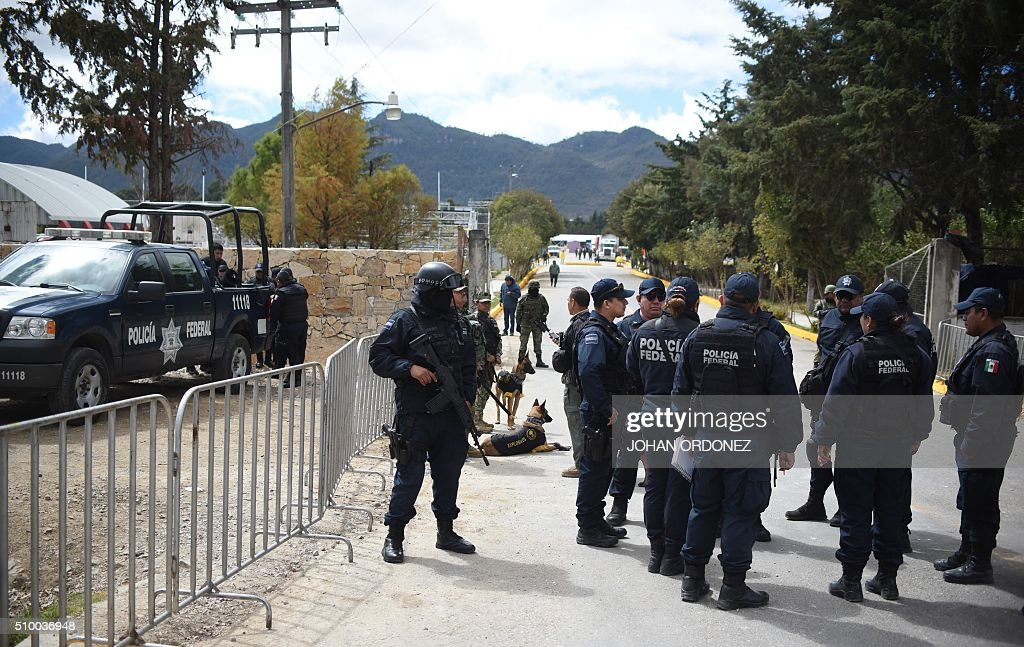 Federal Police personnel stand by on the site where Pope Francis will officiate mass at the Centro Deportivo Municipal (Municipal Sport Center) in San Cristobal de las Casas, Chiapas State, Mexico on February 13, 2016. ope Francis urged Mexican bishops Saturday to take on drug trafficking with 'prophetic courage,' warning that it represents a moral challenge to society and the church. AFP PHOTO/Johan ORDONEZ / AFP / JOHAN ORDONEZ