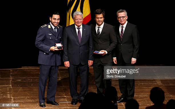 Federal President Joachim Gauck and German Minister of the Interior Thomas de Maiziere pose with the award recipients boxer Artem Harutyunyan and...