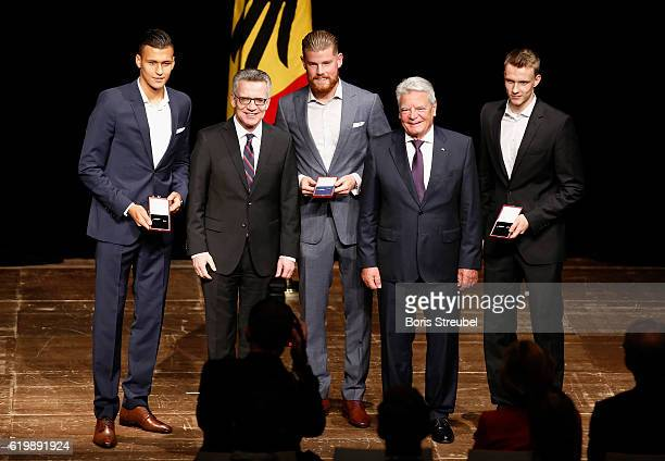 Federal President Joachim Gauck and German Minister of the Interior Thomas de Maiziere pose with members of the german U21 football national team...