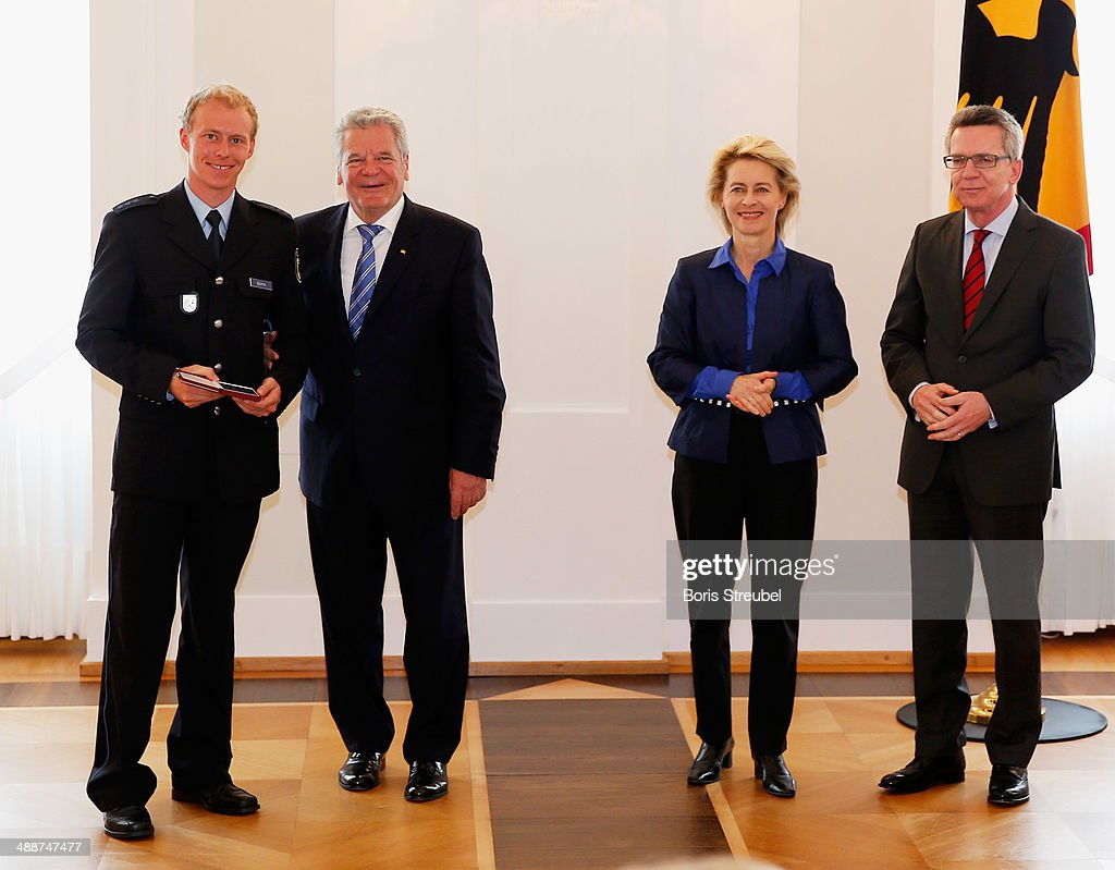 Federal President Joachim Gauck (2.L) awards Daniel Boehm (L), Germany's silver medalist for the the men's 4 x 7.5 km Relay the Silbernes Lorbeerblatt during the Silbernes Lorbeerblatt Award Ceremony at Schloss Bellevue on May 8, 2014 in Berlin, Germany.