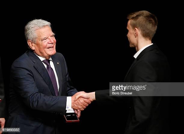Federal President Joachim Gauck awards Lukas Klostermann of the german U21 football national team the Silbernes Lorbeerblatt during the Silbernes...