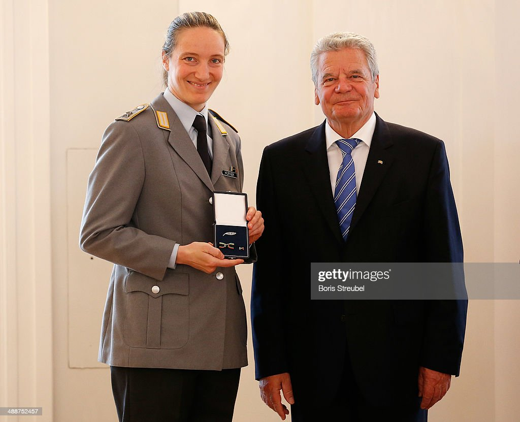 Federal President Joachim Gauck (R) awards Tatjana Huefner, silver medalist of the woman's Luge Singles the Silbernes Lorbeerblatt during the Silbernes Lorbeerblatt Award Ceremony at Schloss Bellevue on May 8, 2014 in Berlin, Germany.
