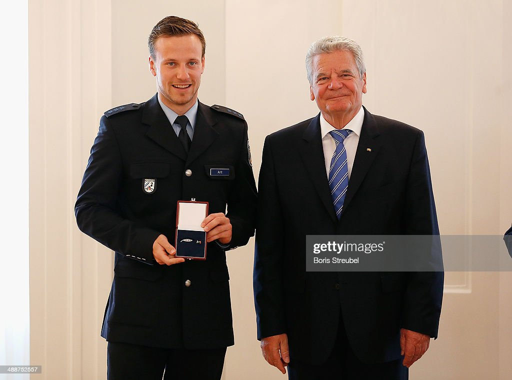 Federal President Joachim Gauck (R) awards Tobias Arlt, gold medalist of the men's Luge Doubles and gold medalist of the Luge Team Relay the Silbernes Lorbeerblatt during the Silbernes Lorbeerblatt Award Ceremony at Schloss Bellevue on May 8, 2014 in Berlin, Germany.