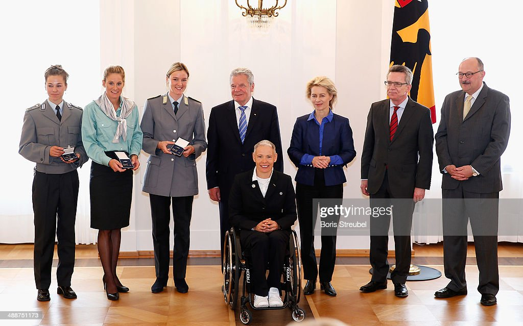 Federal President <a gi-track='captionPersonalityLinkClicked' href=/galleries/search?phrase=Joachim+Gauck&family=editorial&specificpeople=2077888 ng-click='$event.stopPropagation()'>Joachim Gauck</a> (C), <a gi-track='captionPersonalityLinkClicked' href=/galleries/search?phrase=Ursula+von+der+Leyen&family=editorial&specificpeople=4249207 ng-click='$event.stopPropagation()'>Ursula von der Leyen</a> (3.R), Germany's minister of defence, German Minister of the Interior <a gi-track='captionPersonalityLinkClicked' href=/galleries/search?phrase=Thomas+de+Maiziere&family=editorial&specificpeople=618845 ng-click='$event.stopPropagation()'>Thomas de Maiziere</a> (2.R) and Michael Meister (R), Germany's parliamentary undersecretary pose with Germany's cross-country skiing medalists during the Silbernes Lorbeerblatt Award Ceremony at Schloss Bellevue on May 8, 2014 in Berlin, Germany.