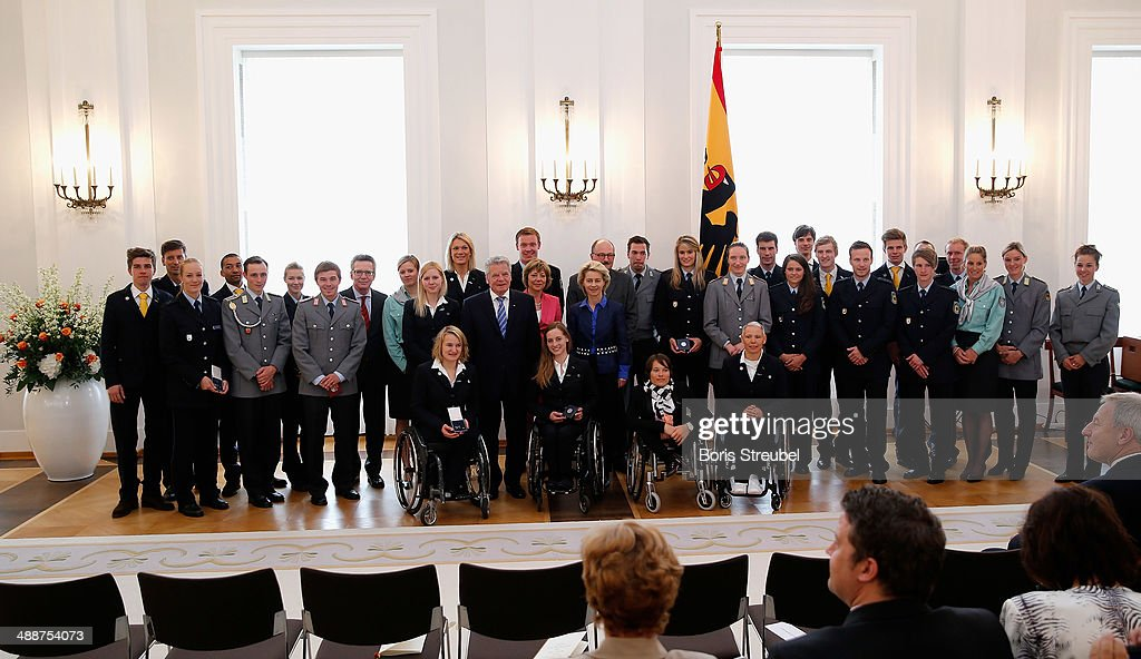 Federal President Joachim Gauck, Ursula von der Leyen, Germany's minister of defence, German Minister of the Interior Thomas de Maiziere and Michael Meister, Germany's parliamentary undersecretary pose with all german olympic medalists after the Silbernes Lorbeerblatt Award Ceremony at Schloss Bellevue on May 8, 2014 in Berlin, Germany.