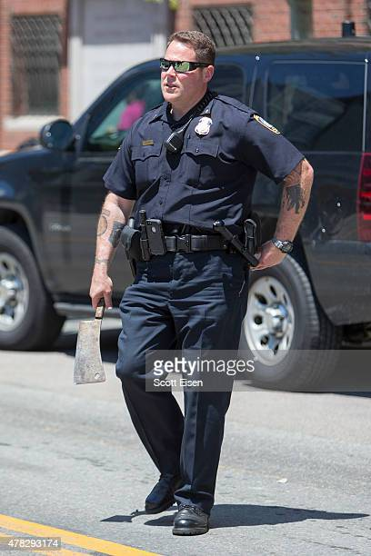 Federal Protective Services Officer holds a meat cleaver found in a car in front of John Joseph Moakley United States Courthouse after a man was...
