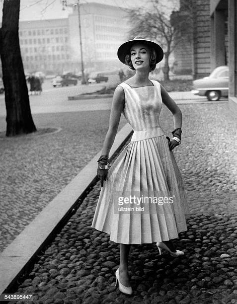 Federal Republic of Germany Model wearing a sleeveless dress with pleated skirt made of cottonsatin Model S E Photographer Karl Ludwig Haenchen...