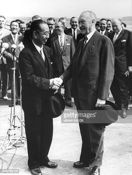 Federal Republic of Germany North RhineWestphalia Cologne German Chancellor Adenauer welcomes Japanese Prime Minister Nobusuke Kishi at Cologne Bonn...