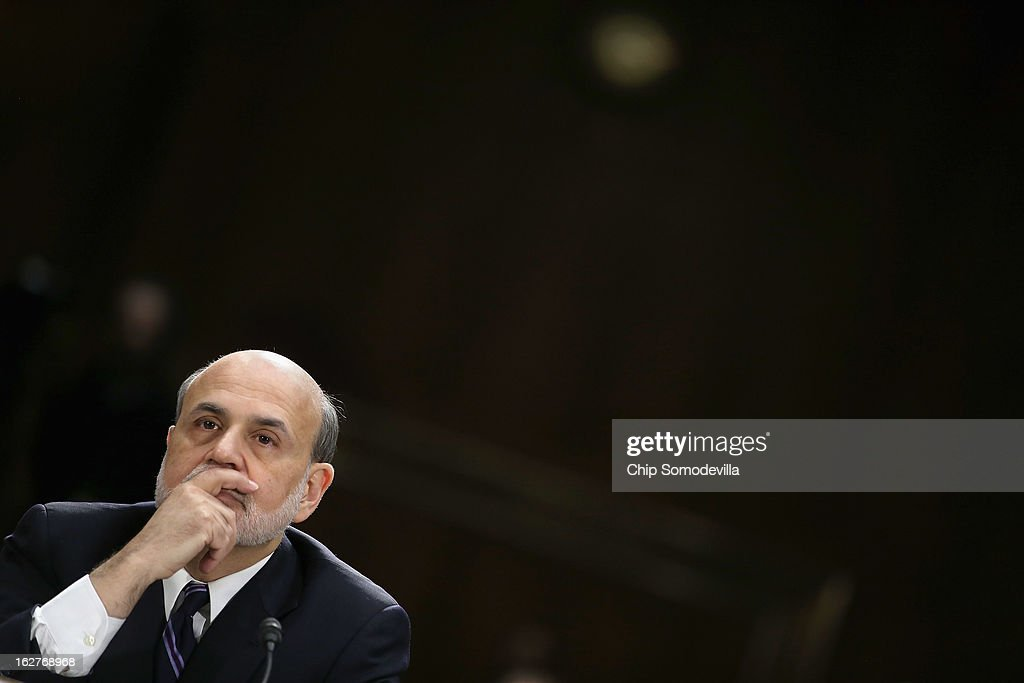 Federal Reserve Bank Chairman <a gi-track='captionPersonalityLinkClicked' href=/galleries/search?phrase=Ben+Bernanke&family=editorial&specificpeople=568098 ng-click='$event.stopPropagation()'>Ben Bernanke</a> testifies before the Senate Banking, Housing and Urban Affairs Committee after the release of The Semiannual Monetary Policy Report to the Congress February 26, 2013 in Washington, DC. Bernanke urged Congress to avoid the harsh sequestration cuts scheduled to begin March 1 with a plan to reduce federal deficits more gradually. He warned the sequestration could harm the economic recovery.