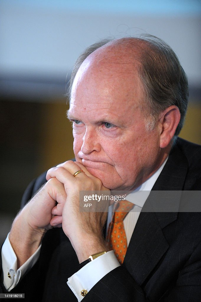 Federal Reserve Bank of Philadelhia President and CEO Charles Plosser listens during a session about 'monetary policy issues' as part of a conference...
