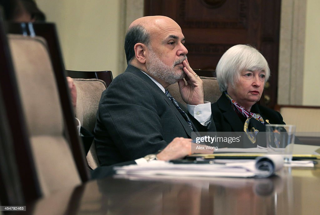 Federal Reserve Board Chairman <a gi-track='captionPersonalityLinkClicked' href=/galleries/search?phrase=Ben+Bernanke&family=editorial&specificpeople=568098 ng-click='$event.stopPropagation()'>Ben Bernanke</a> (L) and <a gi-track='captionPersonalityLinkClicked' href=/galleries/search?phrase=Janet+Yellen&family=editorial&specificpeople=2731344 ng-click='$event.stopPropagation()'>Janet Yellen</a> (R), Vice Chair and President Obama's nominee fto succeed Bernanke, listen during a meeting of the Board of Governors of the Federal Reserve System to discuss the final version of the so-called 'Volcker Rule' December 10, 2013 in Washington, DC. The rule was adopted unanimously during the meeting that will ban proprietary trading by large banks.