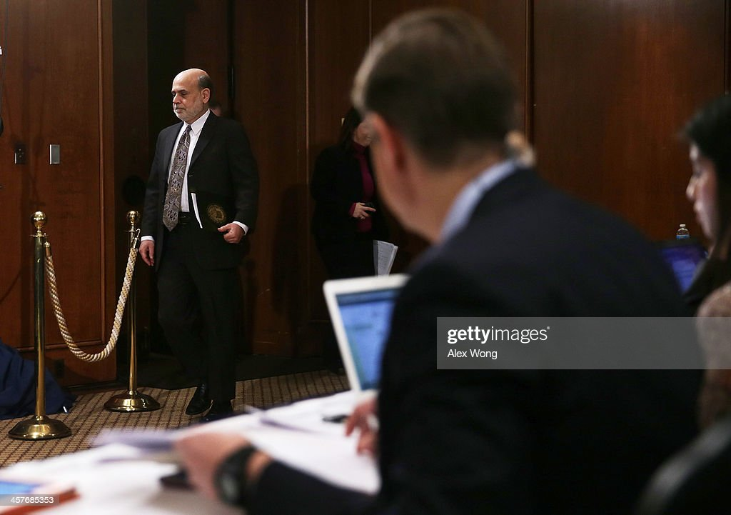 Federal Reserve Board Chairman Ben Bernanke arrives at a news conference after a Federal Open Market Committee (FOMC) meeting December 18, 2013 at the Federal Reserve in Washington, DC. The Federal Reserve has announced that it will scale back its U.S. Treasury bonds and mortgage-backed securities buying program to $75 billion each month.
