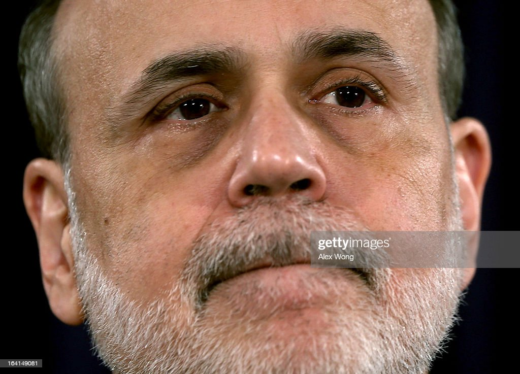 Federal Reserve Board Chairman <a gi-track='captionPersonalityLinkClicked' href=/galleries/search?phrase=Ben+Bernanke&family=editorial&specificpeople=568098 ng-click='$event.stopPropagation()'>Ben Bernanke</a> listens during a news conference at the Federal Reserve headquarters March 20, 2013 in Washington, DC. Bernanke held a news conference to discuss the U.S. economy and interest rates.
