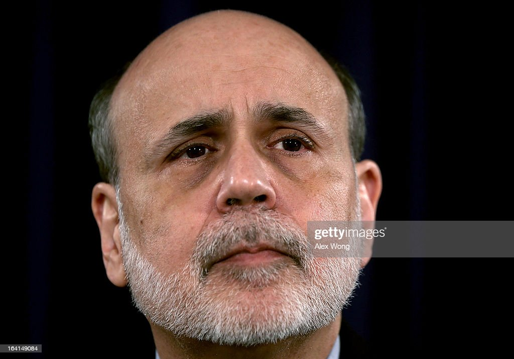 Federal Reserve Board Chairman <a gi-track='captionPersonalityLinkClicked' href=/galleries/search?phrase=Ben+Bernanke&family=editorial&specificpeople=568098 ng-click='$event.stopPropagation()'>Ben Bernanke</a> pauses during a news conference at the Federal Reserve headquarters March 20, 2013 in Washington, DC. Bernanke held a news conference to discuss the U.S. economy and interest rates.