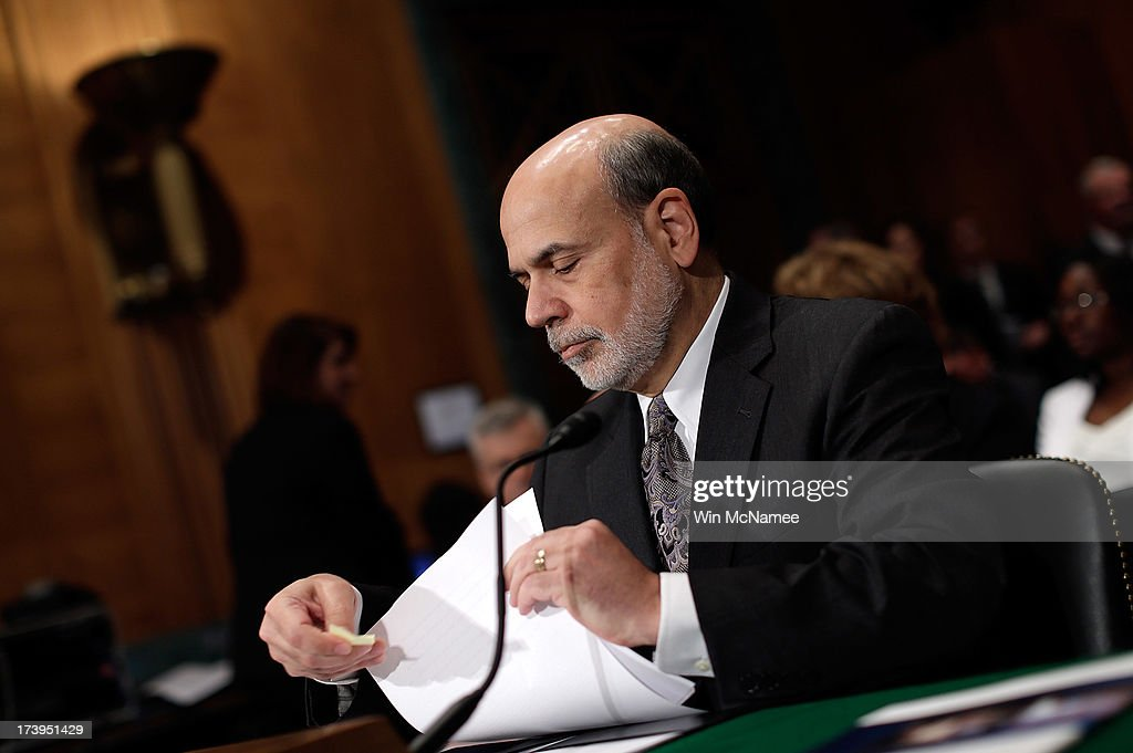 Federal Reserve Board Chairman <a gi-track='captionPersonalityLinkClicked' href=/galleries/search?phrase=Ben+Bernanke&family=editorial&specificpeople=568098 ng-click='$event.stopPropagation()'>Ben Bernanke</a> prepares to testify before the Senate Banking, Housing and Urban Affairs Committee July 18, 2013 in Washington, DC. Bernanke testified on the semi-annual monetary policy report to Congress
