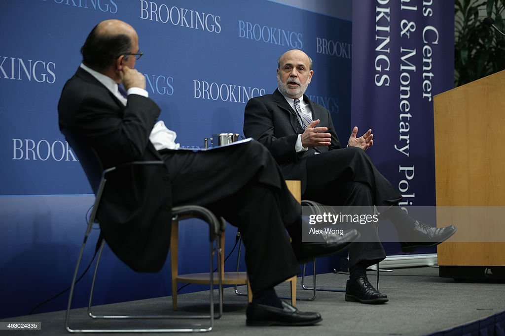 Federal Reserve Board Chairman <a gi-track='captionPersonalityLinkClicked' href=/galleries/search?phrase=Ben+Bernanke&family=editorial&specificpeople=568098 ng-click='$event.stopPropagation()'>Ben Bernanke</a> (R) speaks as author and a member of the Board of Trustees of the Brookings Institution Liaquat Ahamed (L) listens during a session at the Brookings Institution January 16, 2014 in Washington, DC. Bernanke spoke on 'Central Banking after the Great Recession: Lessons Learned and Challenges Ahead.'