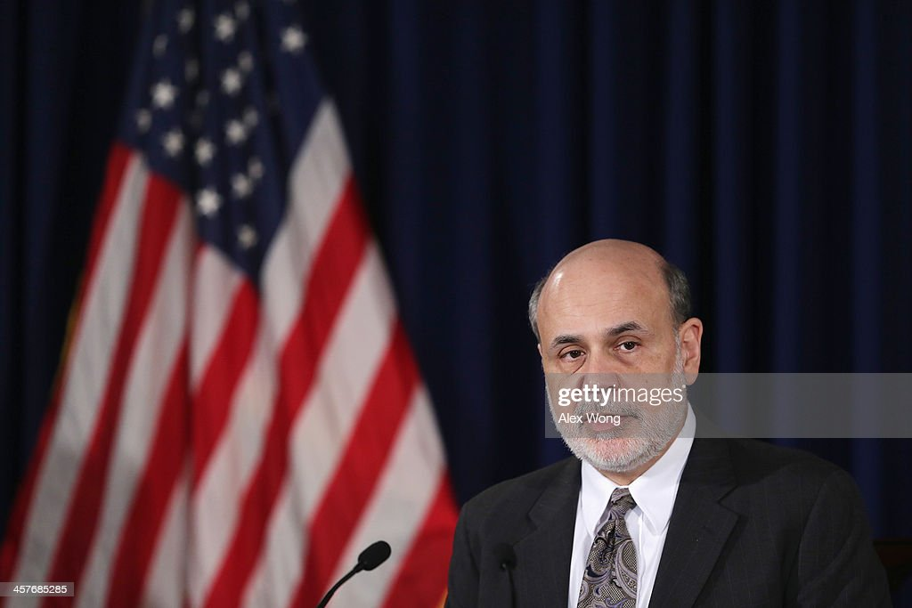 Federal Reserve Board Chairman <a gi-track='captionPersonalityLinkClicked' href=/galleries/search?phrase=Ben+Bernanke&family=editorial&specificpeople=568098 ng-click='$event.stopPropagation()'>Ben Bernanke</a> speaks during a news conference after a Federal Open Market Committee (FOMC) meeting December 18, 2013 at the Federal Reserve in Washington, DC. The Federal Reserve has announced that it will scale back its U.S. Treasury bonds and mortgage-backed securities buying program to $75 billion each month.