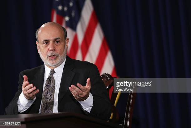 Federal Reserve Board Chairman Ben Bernanke speaks during a news conference after a Federal Open Market Committee meeting December 18 2013 at the...