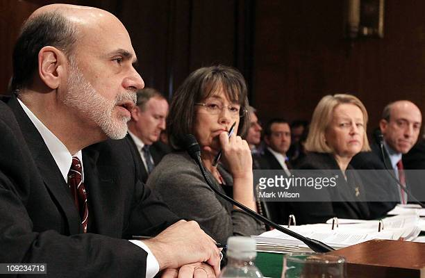 Federal Reserve Board Chairman Ben Bernanke speaks while Sheila Bair chairman of the Federal Deposit Insurance Corporation Mary Schapiro chairman of...