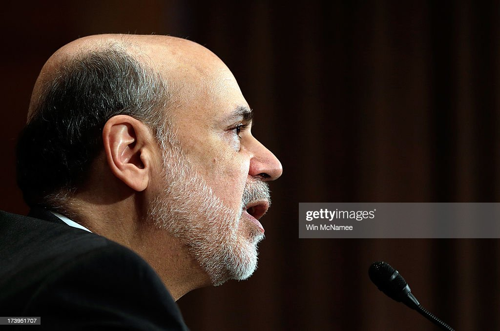 Federal Reserve Board Chairman <a gi-track='captionPersonalityLinkClicked' href=/galleries/search?phrase=Ben+Bernanke&family=editorial&specificpeople=568098 ng-click='$event.stopPropagation()'>Ben Bernanke</a> testifies before the Senate Banking, Housing and Urban Affairs Committee July 18, 2013 in Washington, DC. Bernanke testified on the semi-annual monetary policy report to Congress