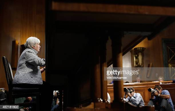 Federal Reserve Board Chairwoman Janet Yellen testifies before the Senate Banking Housing and Urban Affairs Committee July 15 2014 in Washington DC...