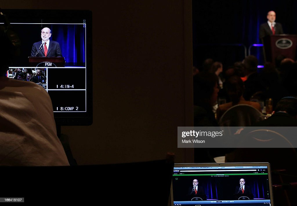 Federal Reserve Board of Governors Chairman Ben Bernanke is seen on monitors speaking during a luncheon at the Renaissance Hotel, April 12, 2013 in Washington, DC. Chairman Bernanke was the keynote speaker at the 2013 Community Development Research Conference, hosted by the Federal Reserve Bank of Atlanta.