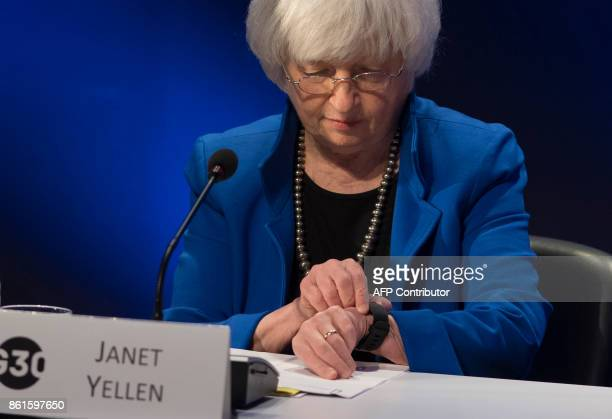 Federal Reserve Chair Janet Yellen checks her watch during the 32nd Annual Group of 30 International Banking Seminar in Washington DC on October 15...