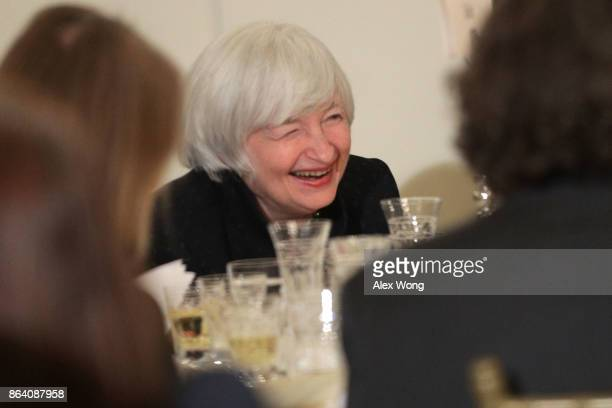 Federal Reserve Chair Janet Yellen laughs as she reacts to remarks during an annual dinner of the National Economists Club at the British Embassy...