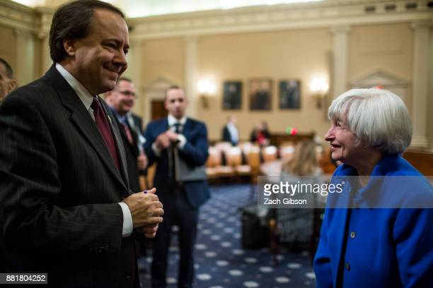 Federal Reserve Chair Janet Yellen speaks to Joint Economic Committee On Economy Chairman Rep Pat Tiberi as she departs after testifying during a...