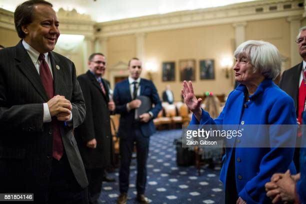 Federal Reserve Chair Janet Yellen waves to Joint Economic Committee On Economy Chairman Rep Pat Tiberi as she departs after testifying during a...