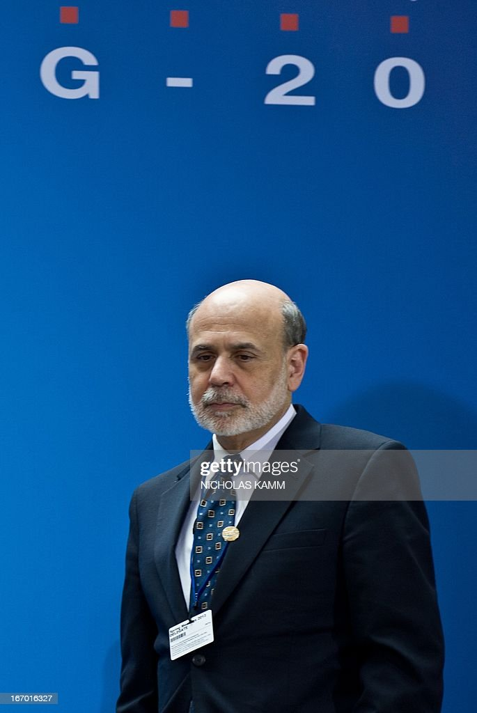 US Federal Reserve chairman Ben Bernanke arrives for a family photo of finance ministers and central bank governors following the G20 meeting at the 2013 World Bank/IMF Spring meetings in Washington on April 19, 2013. AFP PHOTO/Nicholas KAMM