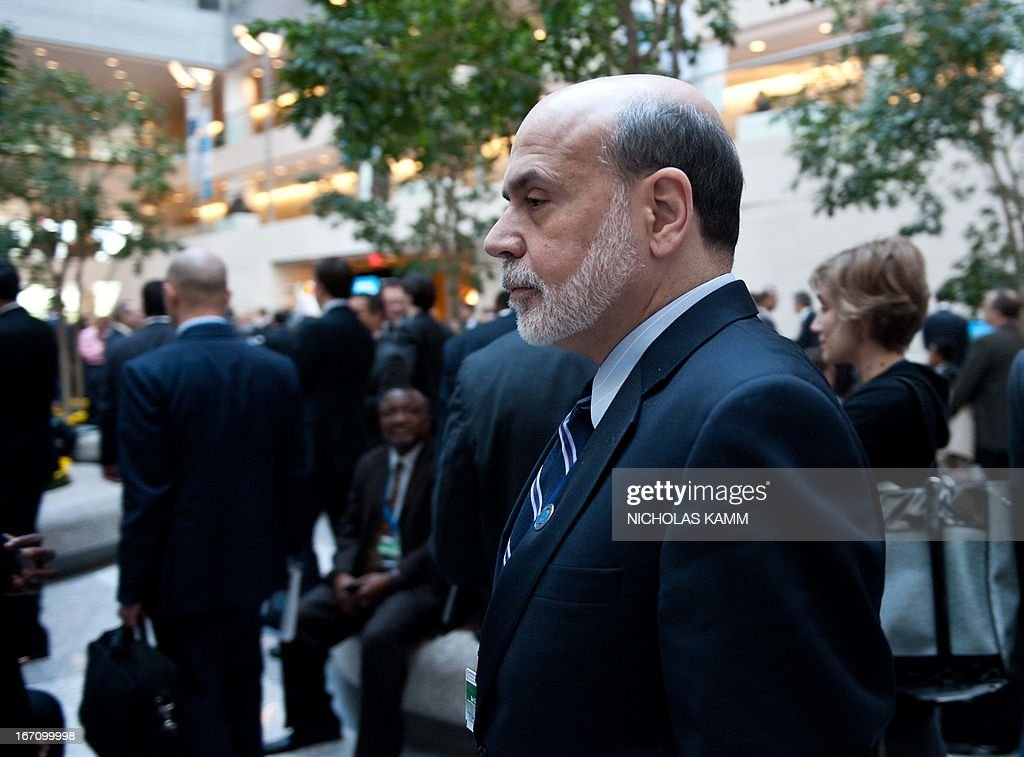 US Federal Reserve chairman Ben Bernanke arrives for the International Monetary and Financial Committee (IMFC) meeting during the 2013 World Bank/IMF Spring meetings in Washington on April 20, 2013. AFP PHOTO/Nicholas KAMM