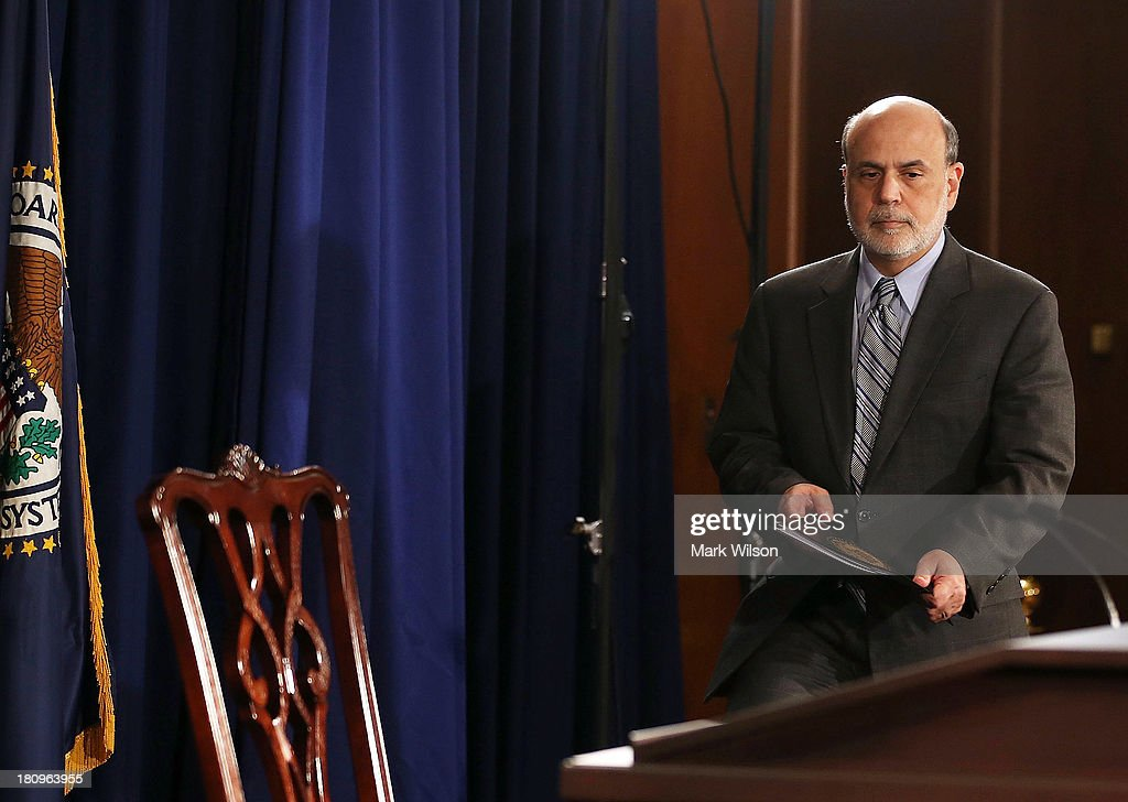 Federal Reserve Chairman <a gi-track='captionPersonalityLinkClicked' href=/galleries/search?phrase=Ben+Bernanke&family=editorial&specificpeople=568098 ng-click='$event.stopPropagation()'>Ben Bernanke</a> arrives to speak at a news conference at the Federal Reserve, September 18, 2013 in Washington, DC. Chairman Bernanke spoke after a closed door meeting of the Federal Open Market Committee. The Federal Reserve announced today that it will not scale back the bond-buying program and continue buying bonds at $85 billion a month.