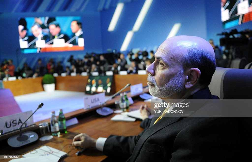 US Federal Reserve Chairman Ben Bernanke attends a meeting of G20 states finance ministers and central bank governors' deputies in Moscow, on February 16, 2013. The ministers and central bank governors' deputies gathered today in Moscow for their first meeting in the Russian capital aimed at reassuring markets that the world's economic powers would not slug it out in 'currency wars' to boost national growth.