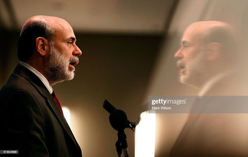 Federal Reserve Chairman Ben Bernanke is reflected in glass as he speaks at the The Federal Deposit Insurance Corporation July 8, 2008 in Arlington, Virginia. Bernanke was speaking to a forum at on mortgage lending for low and moderate income households.