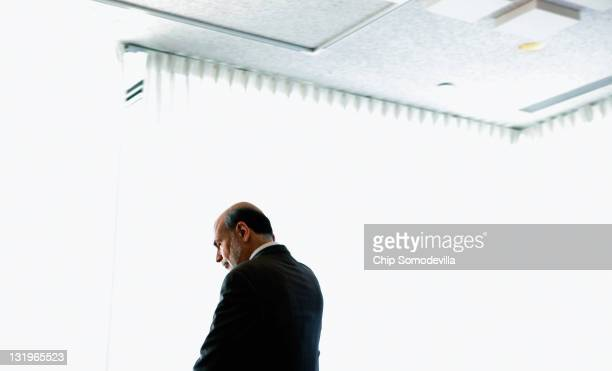 Federal Reserve Chairman Ben Bernanke leaves after delivering opening remarks during a conference on small businss and entrepreneurship at the...
