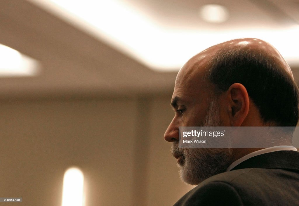 Federal Reserve Chairman Ben Bernanke listens at the The Federal Deposit Insurance Corporation July 8, 2008 in Arlington, Virginia. Bernanke was speaking to a forum at on mortgage lending for low and moderate income households.
