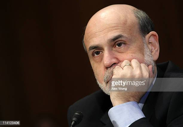 Federal Reserve Chairman Ben Bernanke listens during a hearing before Senate Banking Housing and Urban Affairs Committee May 12 2011 on Capitol Hill...