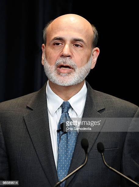 Federal Reserve Chairman Ben Bernanke makes brief remarks during the unveiling of the new $100 note in the Cash Room at the Treasury Department April...