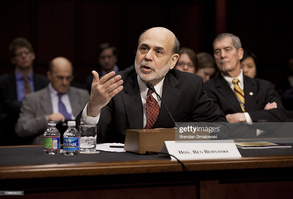 Federal Reserve Chairman <a gi-track='captionPersonalityLinkClicked' href=/galleries/search?phrase=Ben+Bernanke&family=editorial&specificpeople=568098 ng-click='$event.stopPropagation()'>Ben Bernanke</a> speaks during a hearing of the Senate Banking, Housing and Urban Affairs Committee on Capitol Hill March 1, 2011 in Washington, DC. The committee called Federal Reserve Chairman <a gi-track='captionPersonalityLinkClicked' href=/galleries/search?phrase=Ben+Bernanke&family=editorial&specificpeople=568098 ng-click='$event.stopPropagation()'>Ben Bernanke</a> to testify about the semi-annual Federal Reserve monetary policy report to Congress.