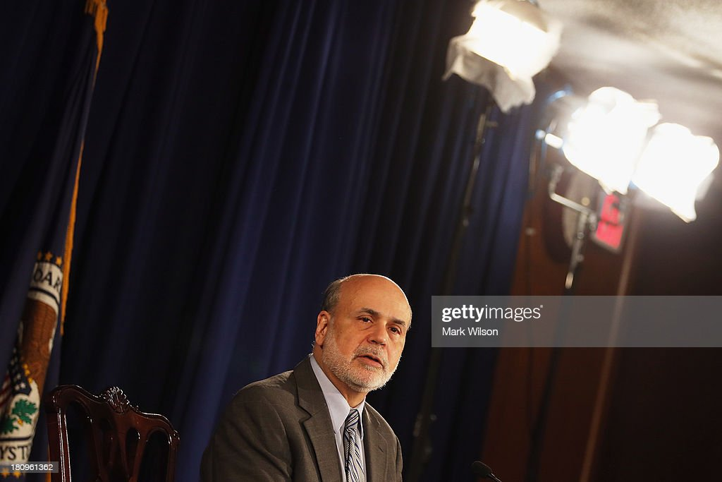 Federal Reserve Chairman <a gi-track='captionPersonalityLinkClicked' href=/galleries/search?phrase=Ben+Bernanke&family=editorial&specificpeople=568098 ng-click='$event.stopPropagation()'>Ben Bernanke</a> speaks during a news conference at the Federal Reserve, September 18, 2013 in Washington, DC. Chairman Bernanke spoke after a closed door meeting of the Federal Open Market Committee. The Federal Reserve announced today that it will not scale back the bond-buying program and continue buying bonds at $85 billion a month.