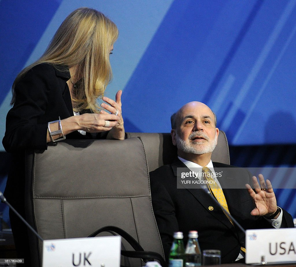 US Federal Reserve Chairman Ben Bernanke (R) speaks with US Treasury Undersecretary Lael Brainard (L) as they attend a meeting of G20 states finance ministers and central bank governors' deputies attend their meeting in Moscow, on February 16, 2013. The ministers and central bank governors' deputies gathered today in Moscow for their first meeting in the Russian capital aimed at reassuring markets that the world's economic powers would not slug it out in 'currency wars' to boost national growth.