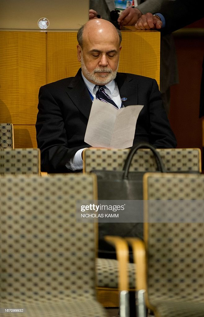 US Federal Reserve chairman Ben Bernanke waits for the start of the International Monetary and Financial Committee (IMFC) meeting during the 2013 World Bank/IMF Spring meetings in Washington on April 20, 2013. AFP PHOTO/Nicholas KAMM
