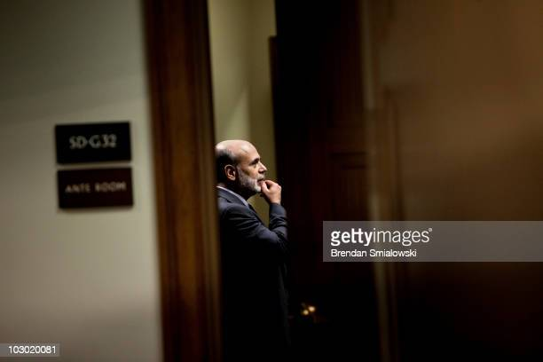 Federal Reserve Chairman Ben Bernanke waits in a back room for a hearing of the Senate Banking Housing and Urban Affairs Committee on Capitol Hill...