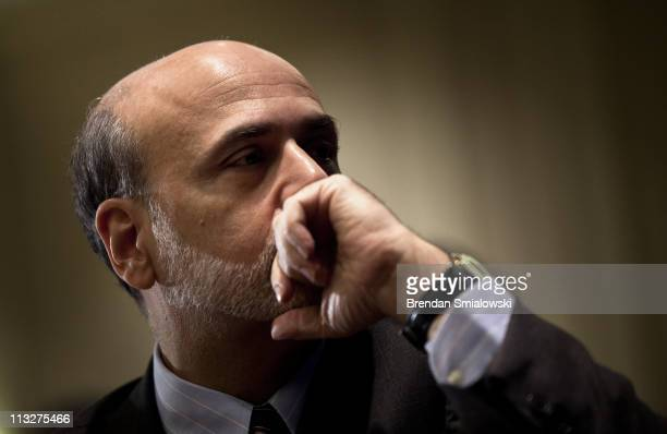 Federal Reserve Chairman Ben Bernanke waits to speak during a luncheon at the 7th Federal Reserve Community Affairs Research Conference April 29 2011...