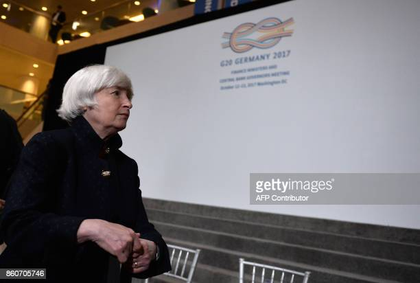 US Federal Reserve Chairman Janet Yellen leaves the stage after the G20 Finance ministers group photo at the IMF headquarters in Washington DC on...