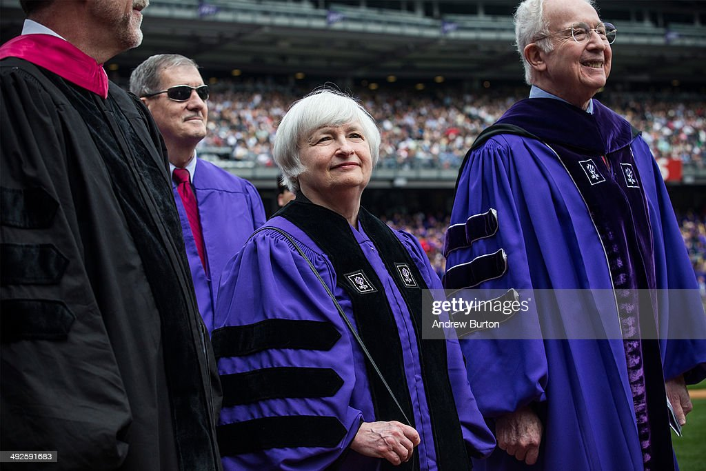 Federal Reserve Chairwoman <a gi-track='captionPersonalityLinkClicked' href=/galleries/search?phrase=Janet+Yellen&family=editorial&specificpeople=2731344 ng-click='$event.stopPropagation()'>Janet Yellen</a> walks in with faculty and staff during commencement ceremonies for New York University at Yankee Stadium on May 21, 2014 in the Bronx borough of New York City. Yellen received an honorary doctorate and was the 2014 commencement speaker.