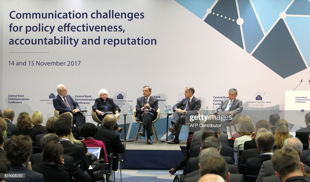 US Federal Reserve chief Janet Yellen, the President of the European Central Bank (ECB) Mario Draghi, Canadian Mark Carney, the governor of the Bank of England, and the governor of the Bank of Japan Haruhiko Kuroda attend a conference titled 'Communications Challenges for Policy Effectiveness' organised by the European Central Bank (ECB) at the ECB headquarters in Frankfurt am Main, western Germany, on November 14, 2017. / AFP PHOTO / Daniel ROLAND