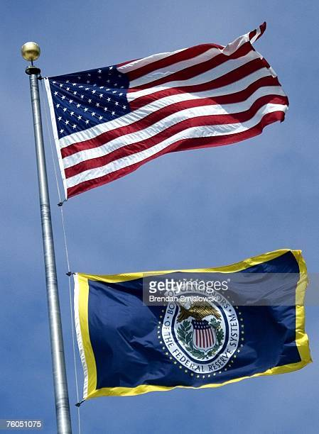 Federal Reserve flag flies below the US flag on the Federal Reserve building August 10 2007 in Washington DC The Federal Reserve injected 38 billion...