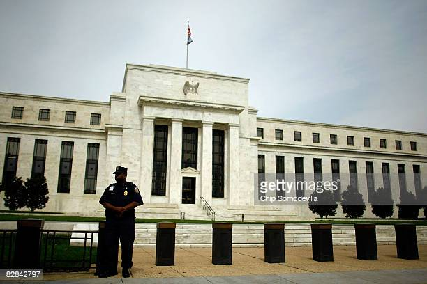 Federal Reserve Law Enforcement officers stand outside the Federal Reserve September 16 2008 in Washington DC The Federal Open Market Committee met...